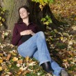 Stock Photo: Woman sleeping under a tree