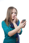 Shocked woman with mobile phone — Stock Photo