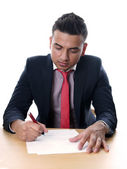 Young man signing contract — Stock Photo