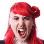 Woman with piercings screaming — Stock Photo