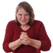 Mature woman rubbing hands — Stock Photo