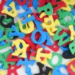 Jumble of foamed rubber letters — Stock Photo