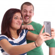 Young couple taking selfie — Stockfoto