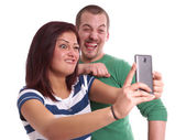 Young couple taking selfie — Stock Photo