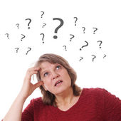 Mature woman with question marks — Stock Photo