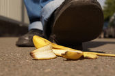 Slipping on a banana peel — Stock Photo