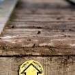 Public footpath sign on wooden walkway — Stock Photo