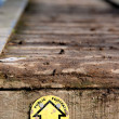 Public footpath sign on wooden walkway - Stock Photo