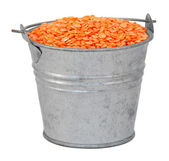 Red lentils in a miniature metal bucket — Stock Photo