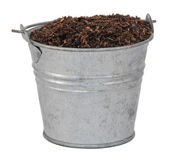 Compost, soil or dirt in a miniature metal bucket — Stock Photo