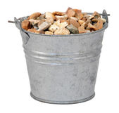 Gravel or small stones in a miniature metal bucket — Stock Photo