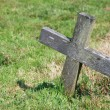 Small wooden cross in a graveyard — Stock Photo