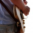 Detail of guitarist playing his guitar — Stock Photo #28160081