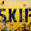 Rusty yellow skip — Stock Photo