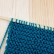 Garter stitch in teal yarn on knitting needle — Stock Photo