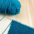 Ball of blue wool with knitting on the needle — Stock Photo