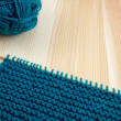 Garter stitch on knitting needle with teal yarn — Stock Photo