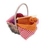 Purple, red and orange wool with knitting in a basket — Stock Photo