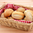 Basket full of fresh bread rolls — Stock Photo