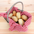 Rustic picnic basket of fresh bread rolls — Stock Photo