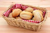 Basket full of fresh bread rolls — Stock Photo