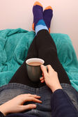 Woman dressed warmly, relaxing with a hot drink — Stock Photo