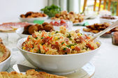 Bowl of rice salad on a buffet table — Stock Photo
