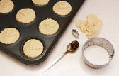 Uncooked mince pies in a bun tin — Stock Photo