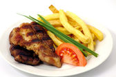 Grilled meat with fries — Stock Photo