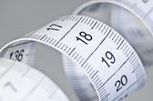 Tailor measure tape swirl closeup — Stock Photo