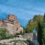 Old ancient church St. John (Jovan Kaneo) lower view at lake Ohrid, Macedonia between the trees — Stock Photo