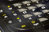Modern black PHA phone keyboard closeup soft focus ASDF — Stock Photo