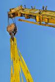 Yellow mobile crane lifting — Stok fotoğraf