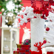 Foto Stock: Christmas and new year white vase and red elements decoration