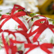 Royalty-Free Stock Photo: White collection of Christmas Balls with red ribons