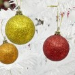 New year and christmass balls on white pine background — Stok fotoğraf