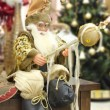 Stock Photo: Santclaus statue decoration posing sitting with new year gree