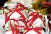 White collection of Christmas Balls with red ribons — Stock Photo