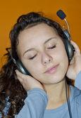 Gorgeous young teenage girl enjoing headphone music — Stock Photo