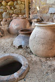 Old clay pot excavations into ancient city ruins close up — Stock Photo