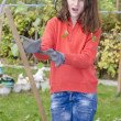Stock Photo: Young girl waiting for stick not hiting her in garden