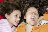 Little sister girls fighting angry in bed — Stock Photo