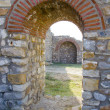 Old arched stone passage in the ancient town citadela ruins — Stock Photo