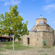 图库照片: Ancient church with green tree and blue sky. St. Nikolold church near ancient town ruins Bargalin Macedonia
