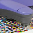 Stock Photo: Spectrophotometer measures color patches on Test Arch, Press shop prepress department