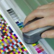 Spectrophotometer verify color patches value on Test Arch, Press shop prepress department — Photo