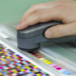 Stock Photo: Spectrophotometer verify color patches on Test Arch, Press shop prepress department