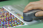 Spectrophotometer measurment of color patches on Test Arch, print plant prepress department — Stock Photo