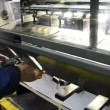 Stock Video: Taking out printed sheet on offset machine for final color management control measurement