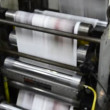 Print press hit set roll paper goes through the rollers after passing the printing units — Stock Video #25119497